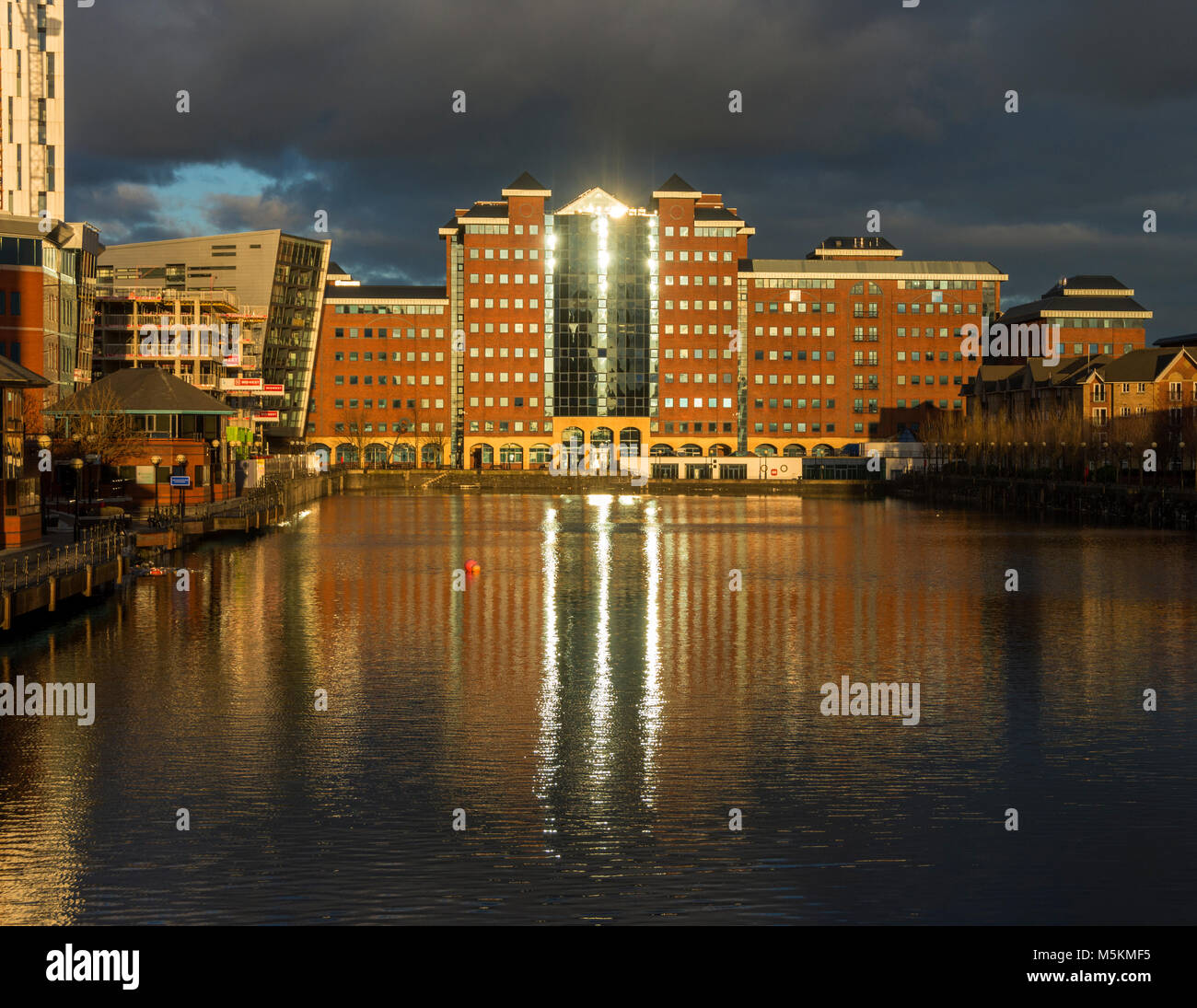 Late afternoon sun on the Anchorage Quay office buildings, Erie Basin, Salford Quays, Manchester, UK - Stock Image
