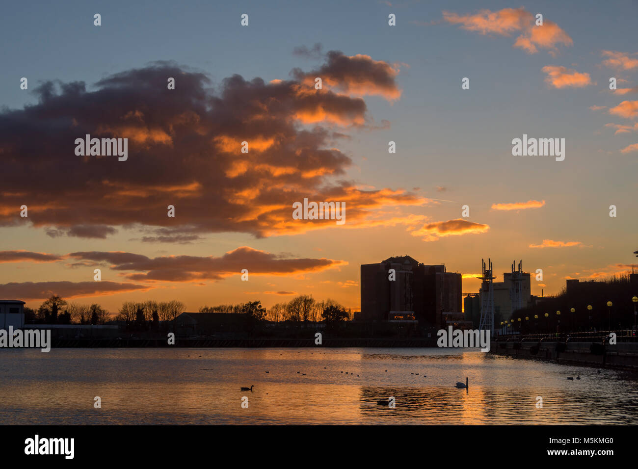 Sunset at Salford Quays, Manchester, UK.  The Quay West office block right of centre. - Stock Image