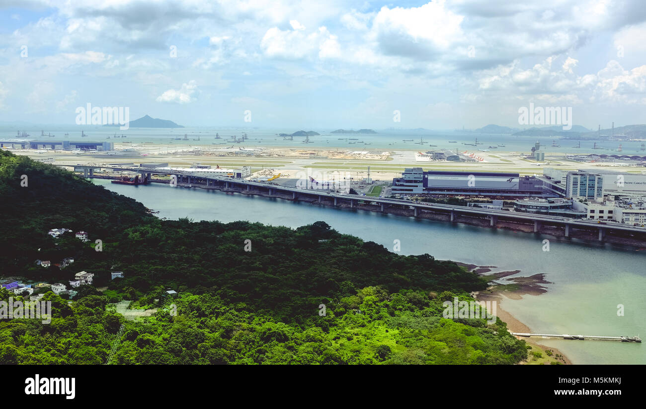 The view of the airport on Lantau Island can be seen from the cable car in Hong Kong - Stock Image