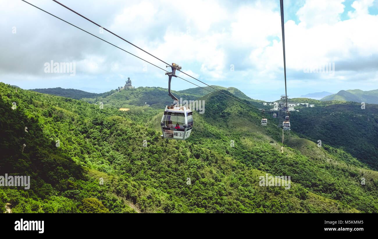 The view of Big Buddha on Lantau Island can be seen from the cable car in Hong Kong - Stock Image