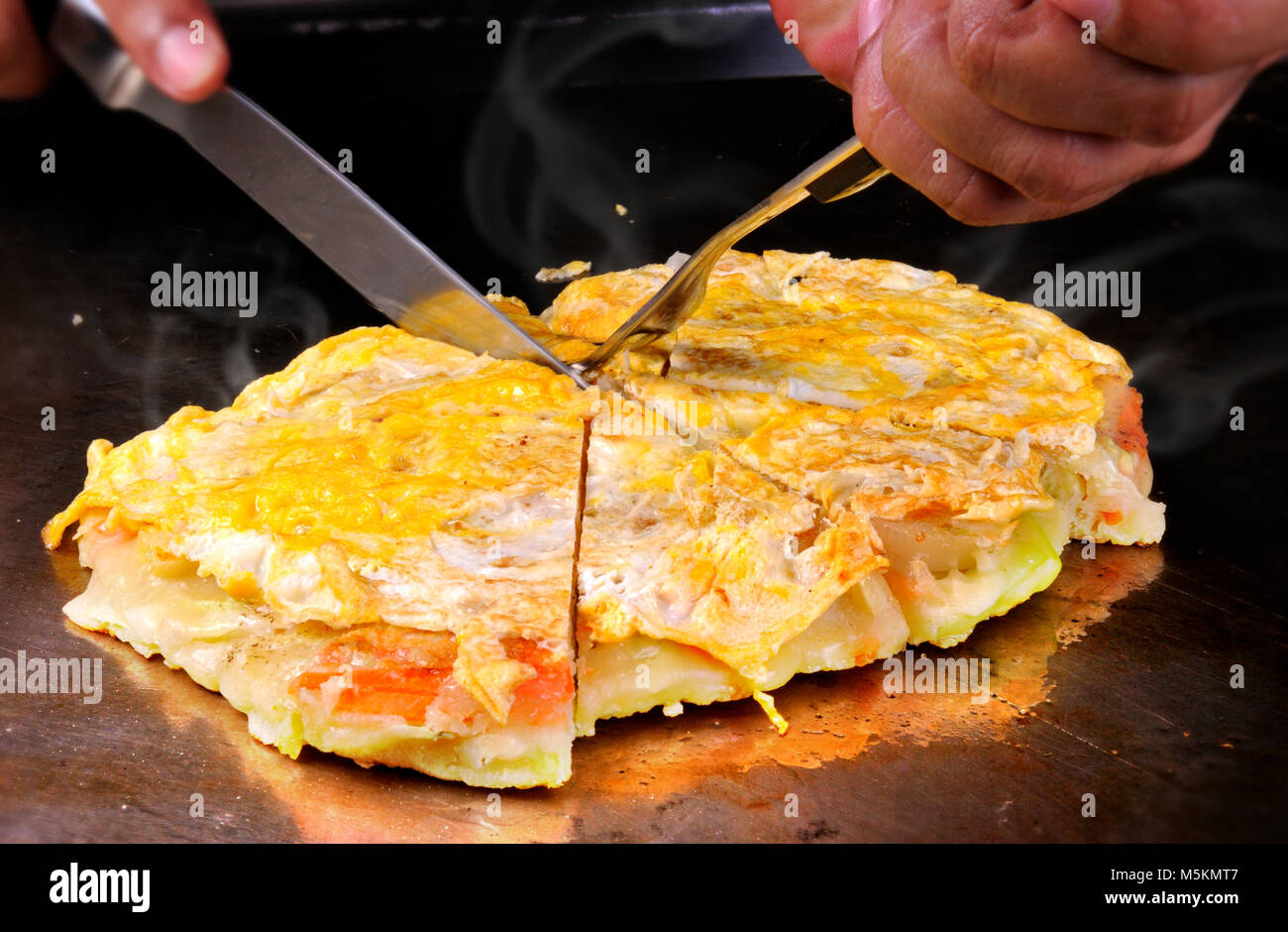 Japanese Okonomiyaki is japanese pizza great and yammy Stock Photo