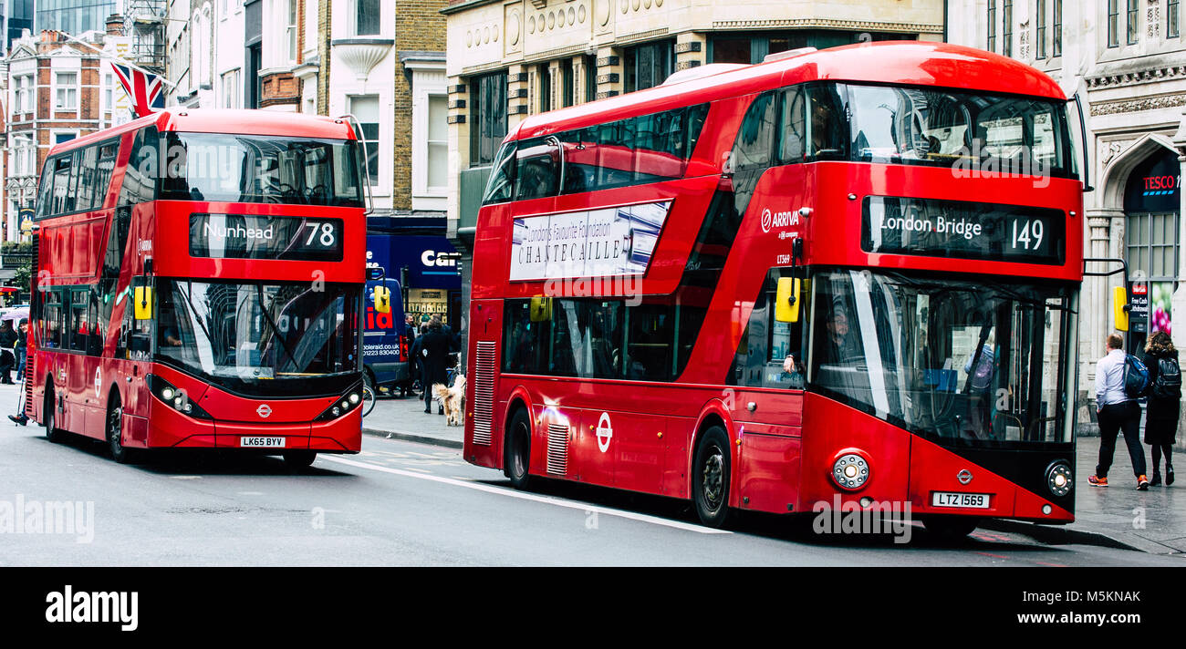 Two new routemaster red London buses pass through the City of London - Stock Image
