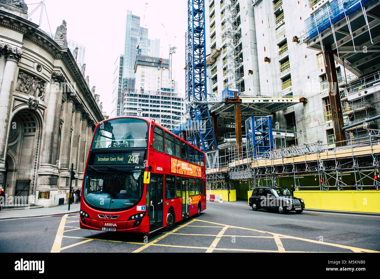 A bus turns toward Bank Junction in the City of London - Stock Image