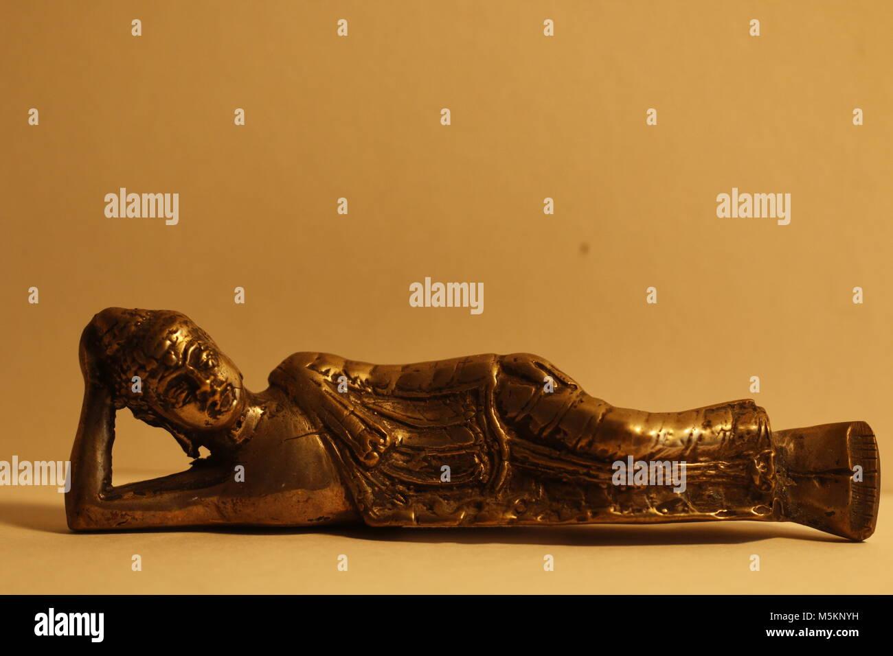 Resting Buddha statue - Stock Image