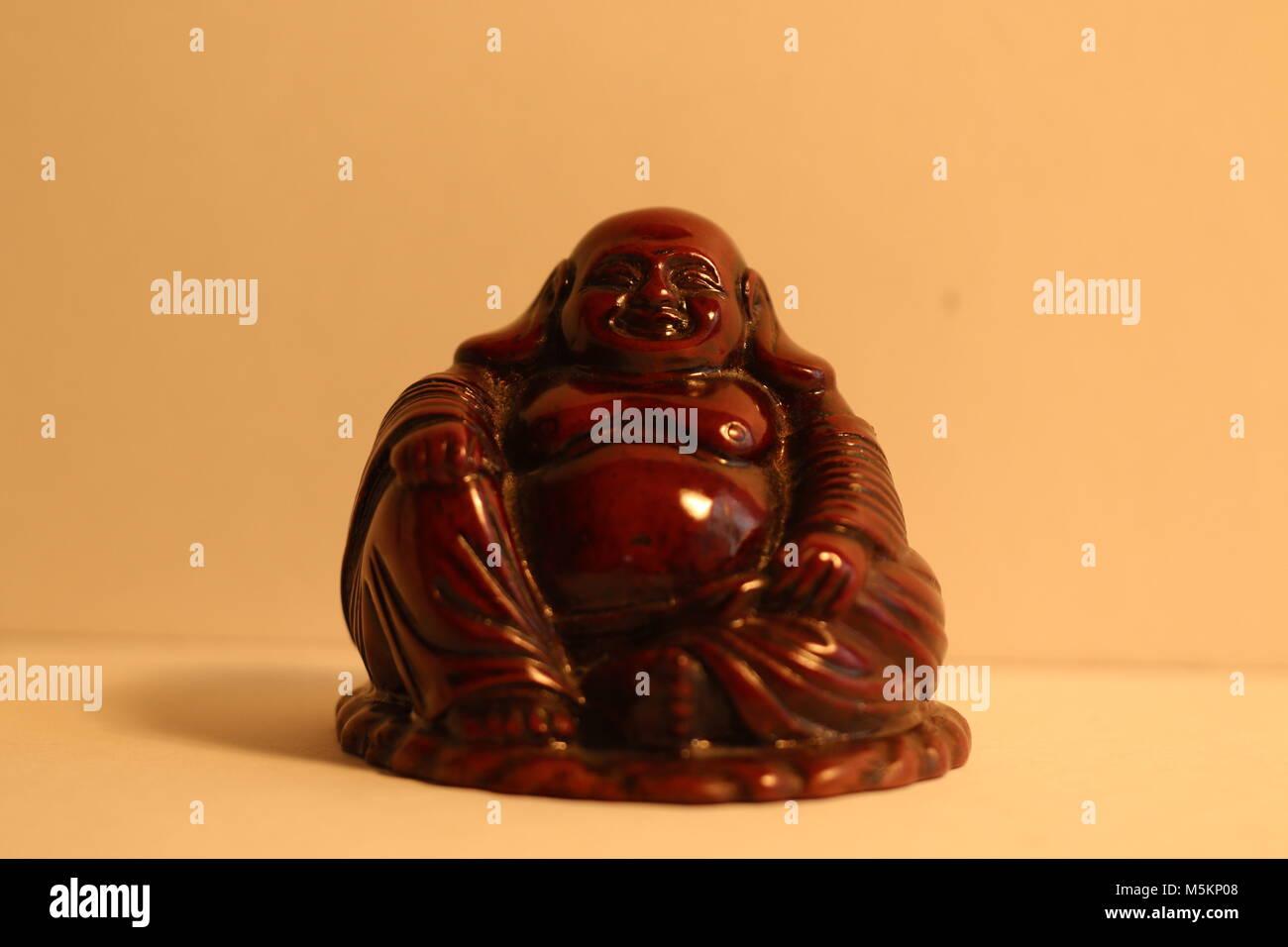 Red stone Chinese Buddha - Stock Image