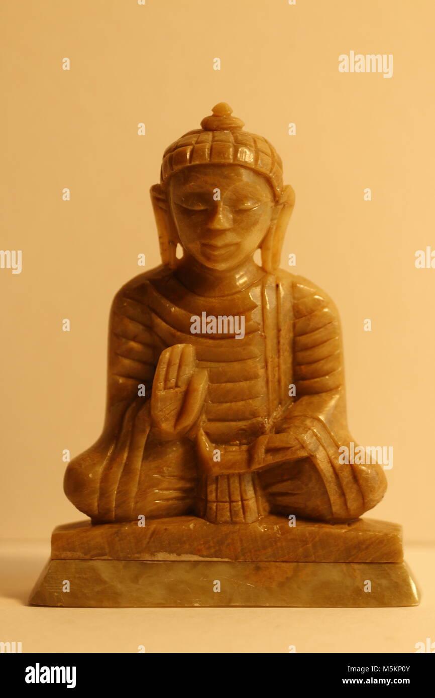 Marble stone Buddha in meditation - Stock Image