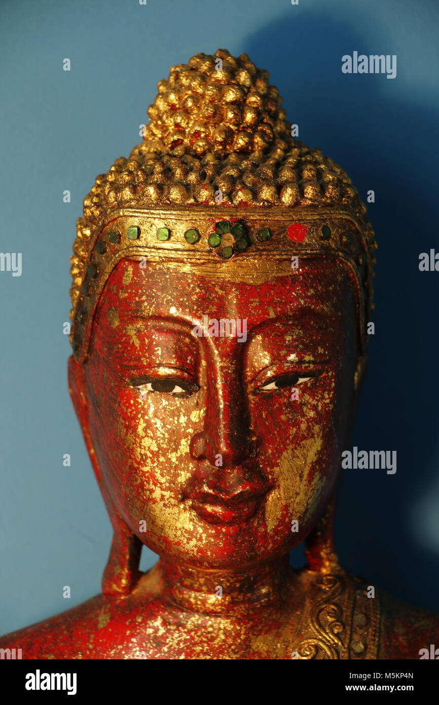 Head of a red golden buddha statue - Stock Image