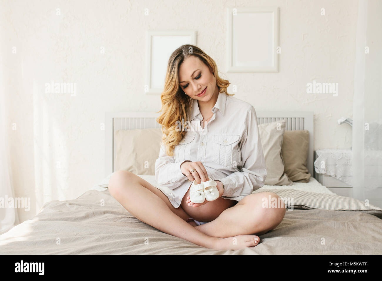 Beautiful adult pregnant woman. Waiting for the baby. Pregnancy. Care, tenderness, motherhood, childbirth. - Stock Image