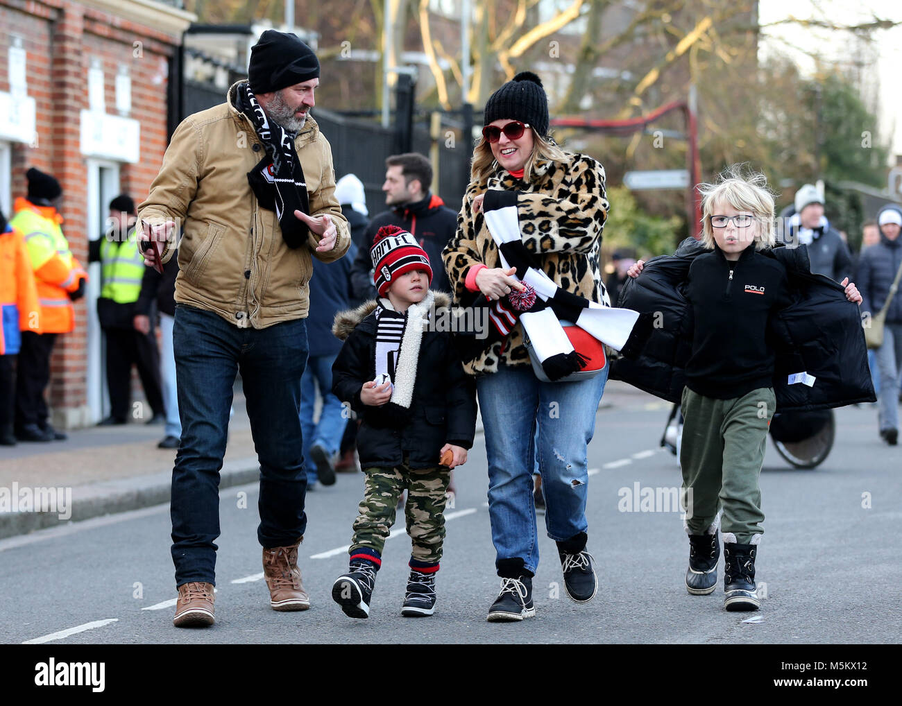 Fulham fans make their way to the ground before the Championship match at Craven Cottage, London. - Stock Image