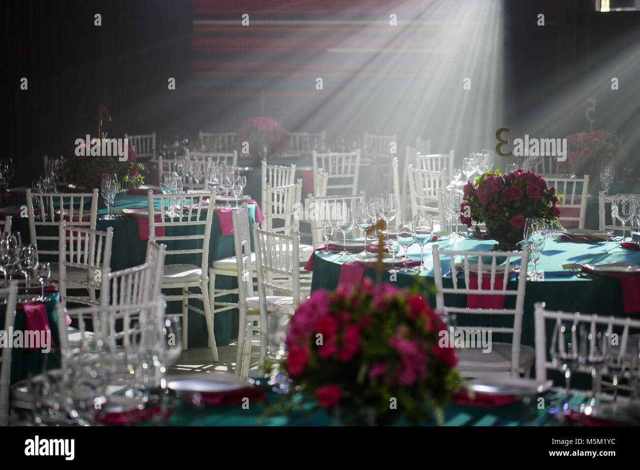 banquet hall or other function facility set for fine dining. - Stock Image