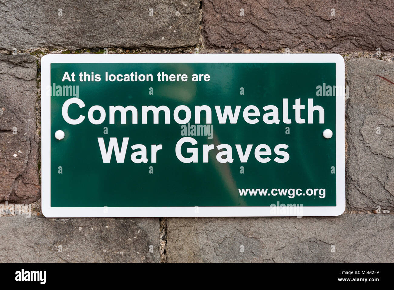 Commonwealth war graves sign outside cemetery. Reading, Berkshire, England, GB, UK - Stock Image