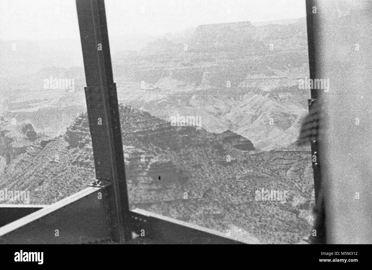 Grand Canyon Historic- Desert View Watchtower Construction c . WATCHTOWER CONSTRUCTION SITE. VIEW THROUGH STEEL Stock Photo