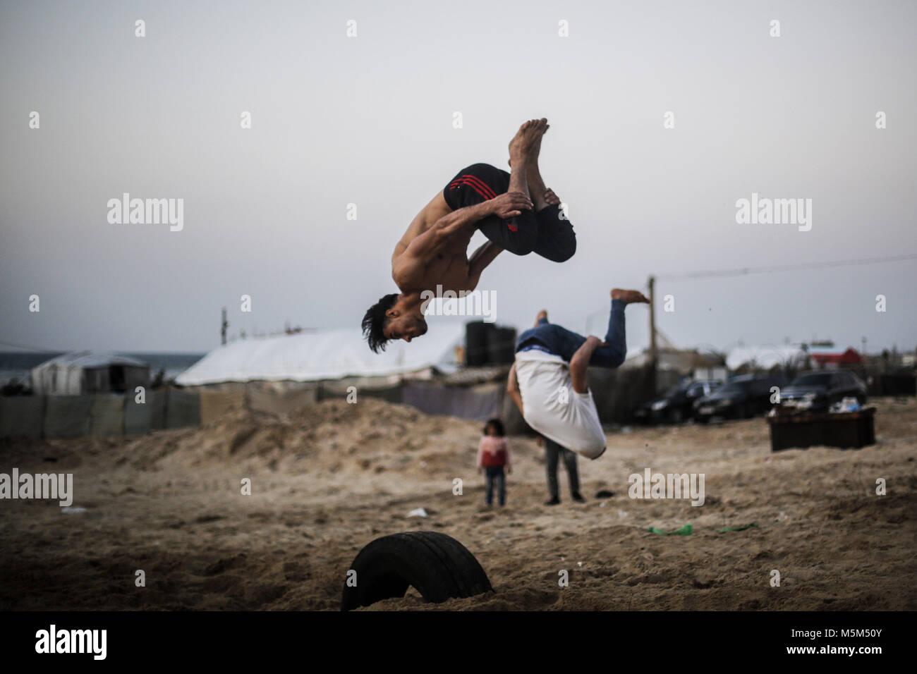 Gaza City, Gaza. 23rd Feb, 2018. Palestinian youth practice their parkour skills on the beach of Gaza City, Gaza, - Stock Image