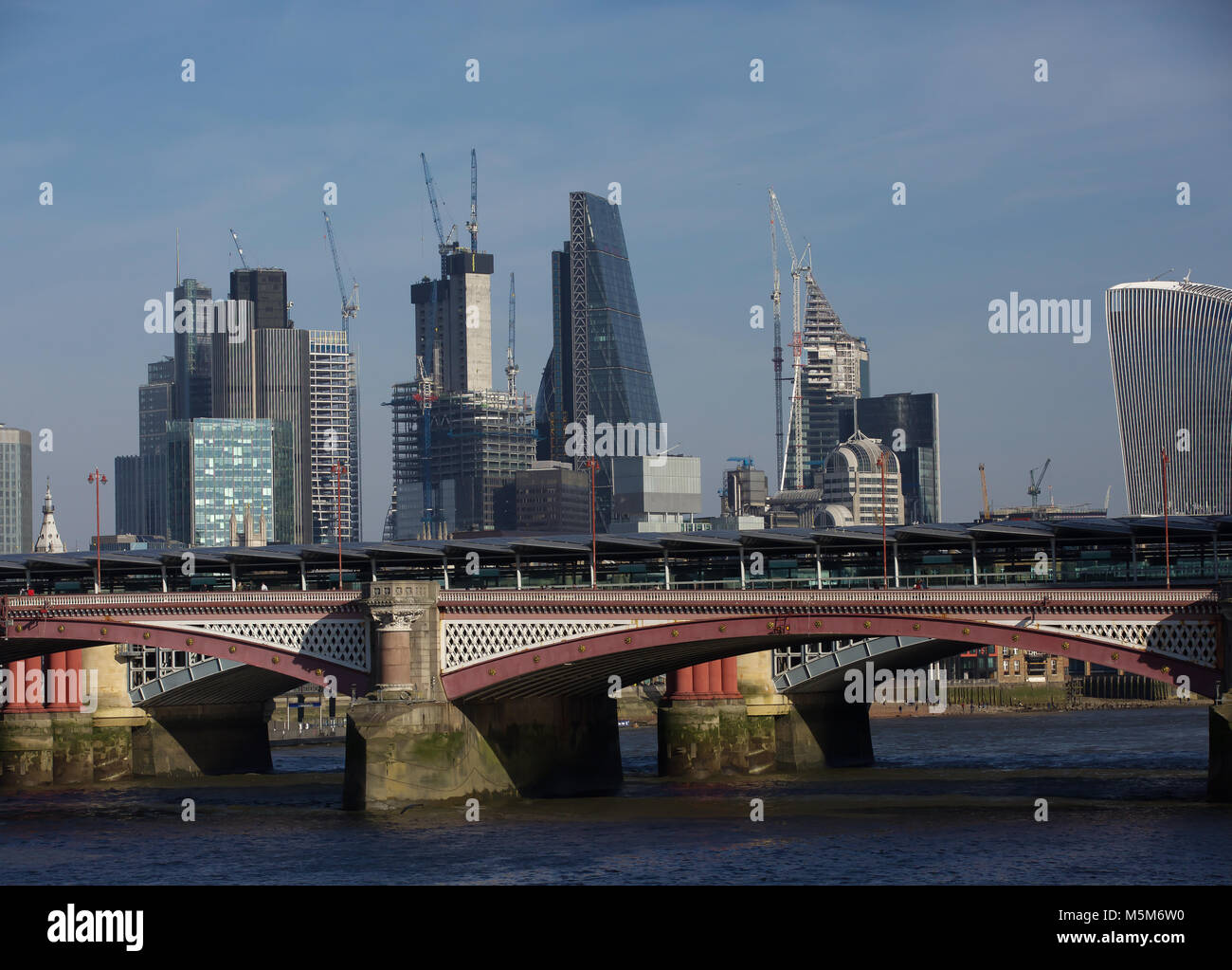London, UK, 24 Feb 2018. Blue skies over the London Skyline and the River Thames©Keith Larby/Alamy Live News - Stock Image