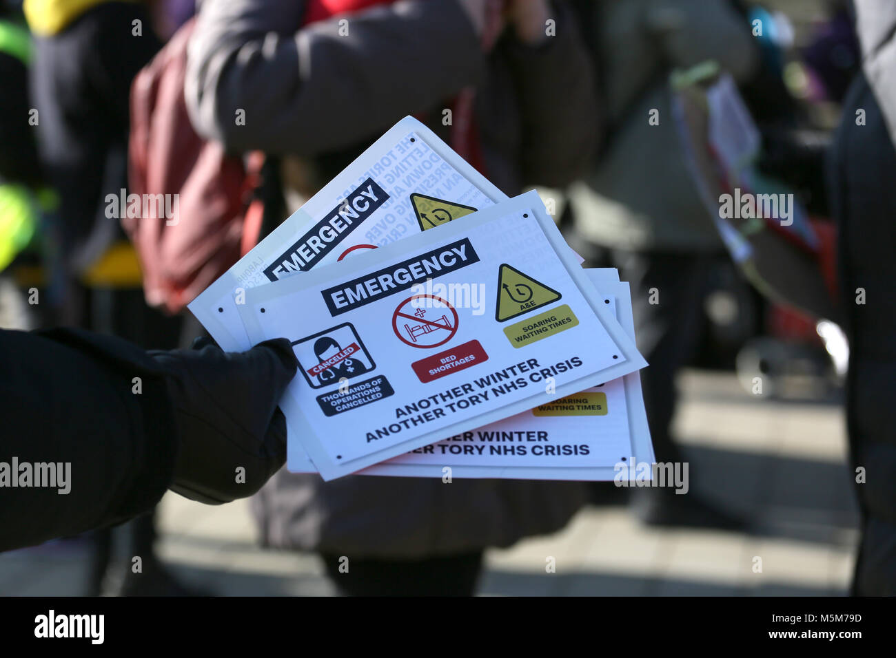 Leaflets around the NHS are handed out at rally to defend the NHS, Bolton, 24th February, 2018 (C)Barbara Cook/Alamy - Stock Image