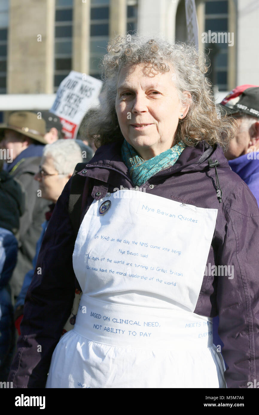 A women wearing a nurses apron with Nye Bevan quotes written on it, Bolton, 24th February, 2018 (C)Barbara Cook/Alamy - Stock Image