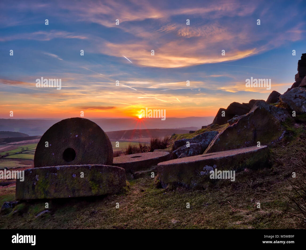 Peak District National Park, Derbyshire, UK. 24th February, 2018. UK Weather: spectacular sunset over the millsones - Stock Image
