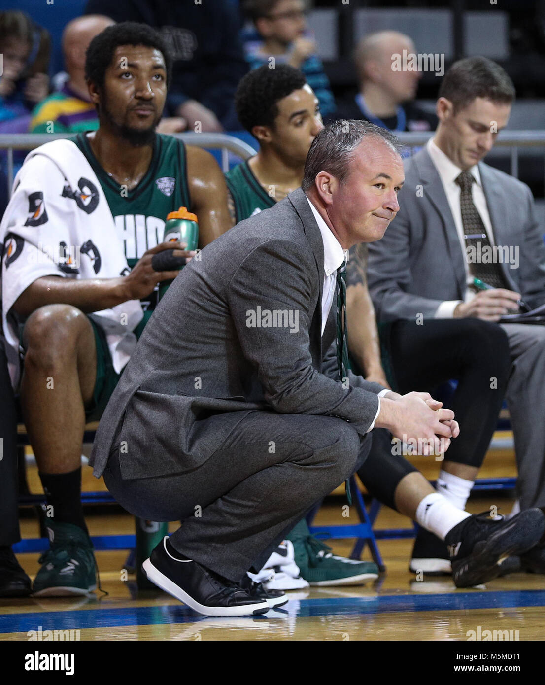 February 24, 2018: Ohio Bobcats head coach Saul Phillips looks on as the final seconds of the first half tick off - Stock Image
