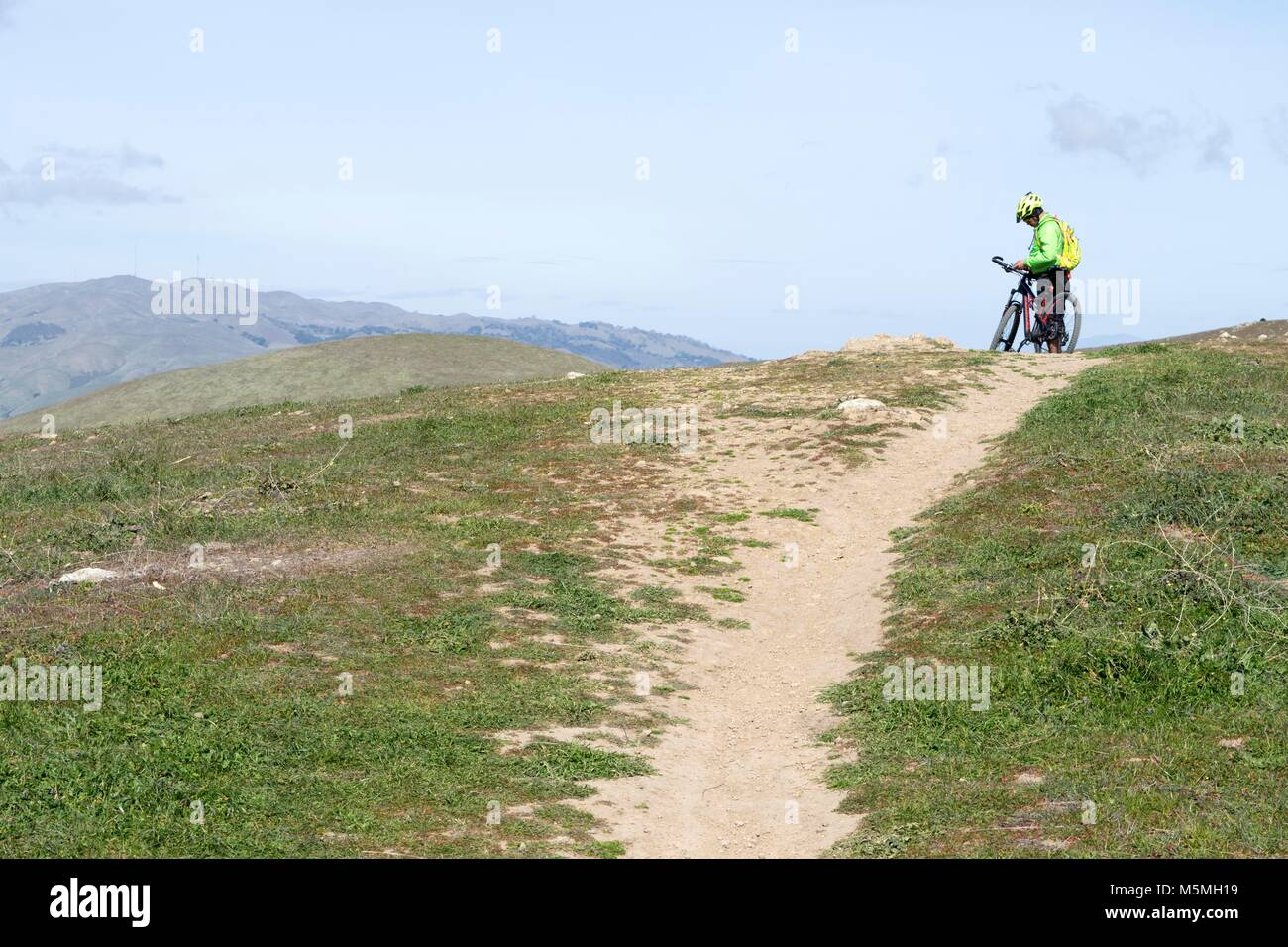 A man takes a break from mountain biking at Sierra Vista in San Jose. Stock Photo