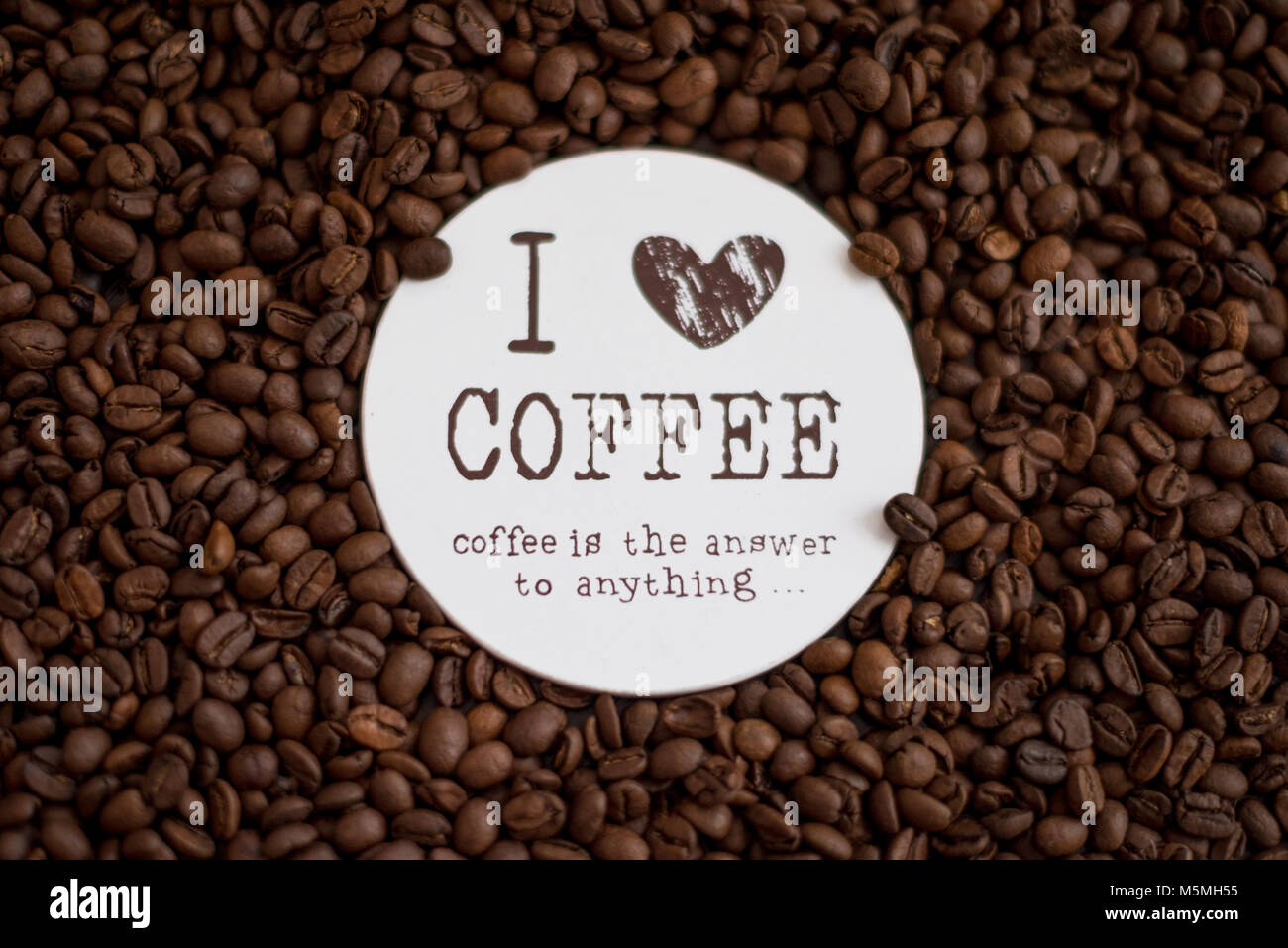 Coffee beans on table with sign I love coffee. - Stock Image