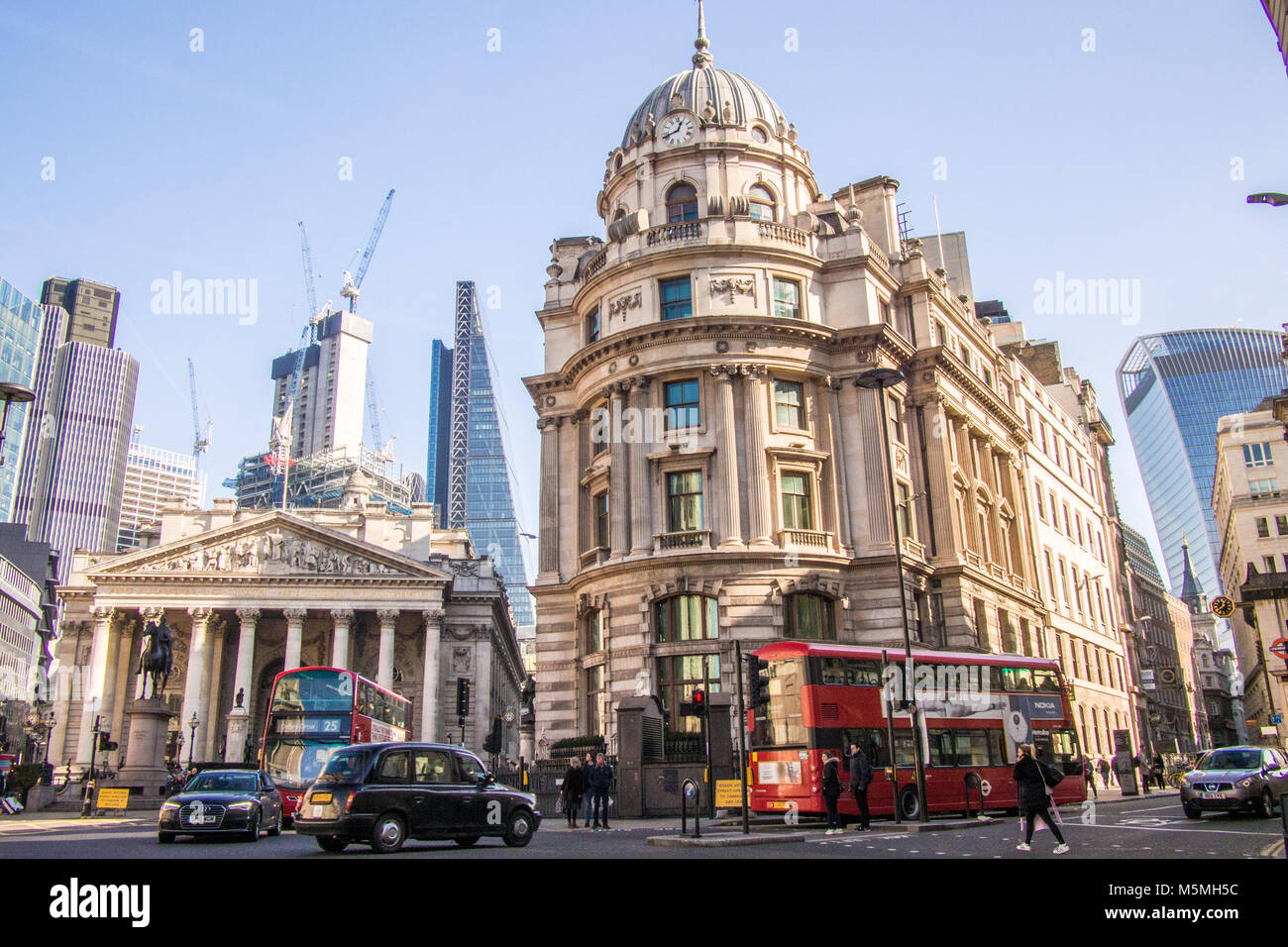 Royal Exchange (left) shopping centre with the famous sky scrapers of the 'Cheese Grater' (mid left) and - Stock Image