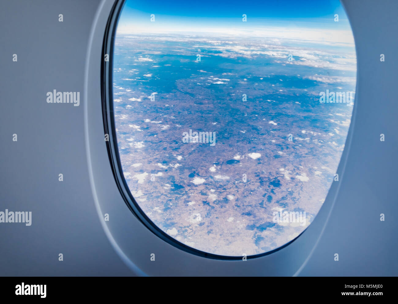 airplane window when flying see through at cloud and blue sky,Transportation,Travel concept. - Stock Image