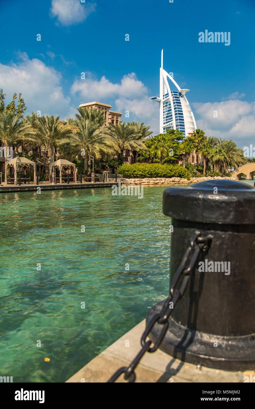 DUBAI, UAE - JANUARY 16, 2014: View of hotel Burj al Arab from Madinat Jumeirah in Dubai. At 321 m, it is the fourth - Stock Image