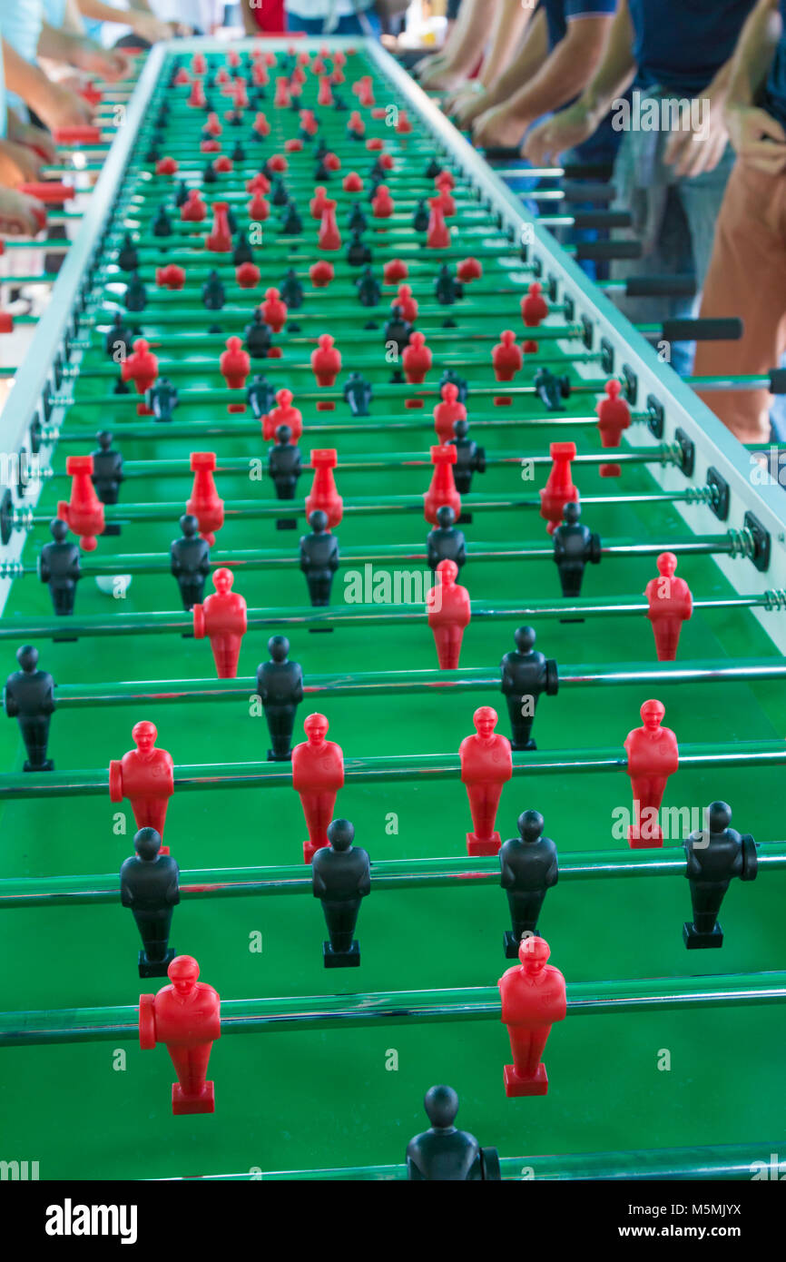 Very Long Table Football Game for Fifty Players Simultaneously. - Stock Image