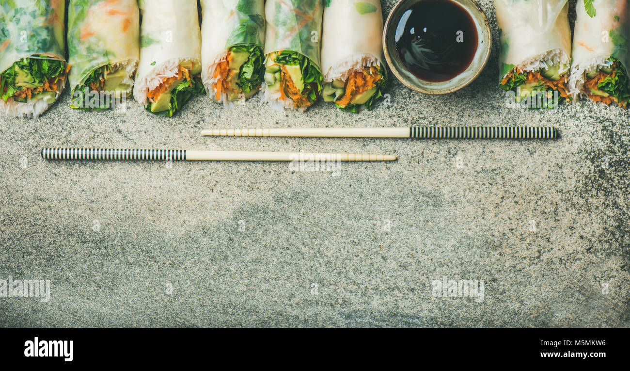 Vegan spring rice paper rolls over concrete background, copy space - Stock Image