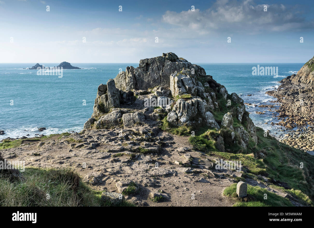 A granite outcrop on a headland overlooking Porth Nanven in Cornwall. - Stock Image