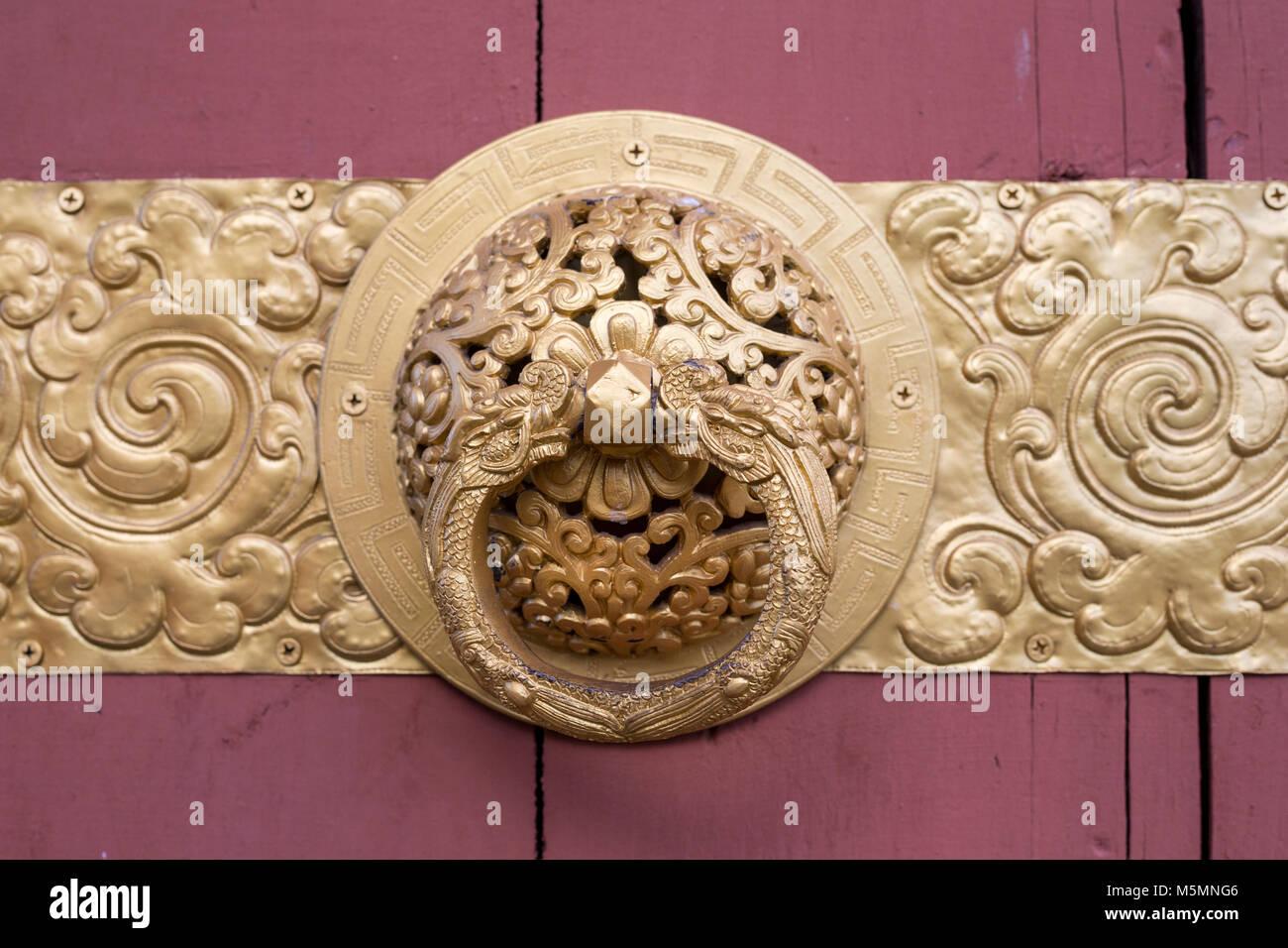 Thimphu, Bhutan.  Decoration on Doorway Opening to the National Memorial Chorten. - Stock Image