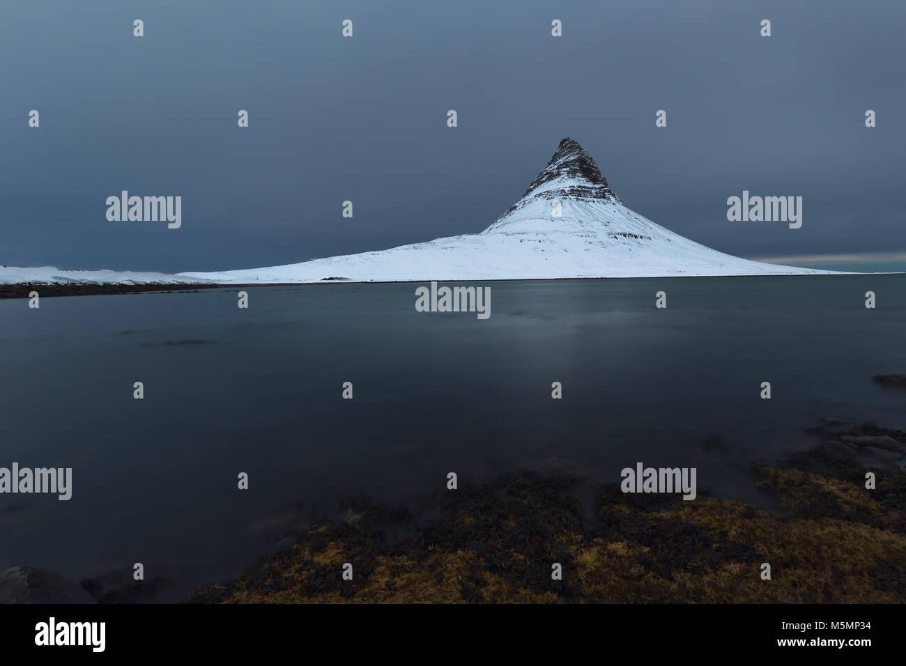 Snowed kirkjufell mountain in winter in Iceland - Stock Image