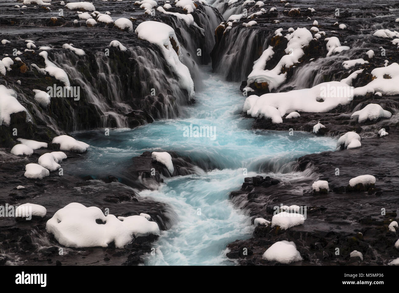 Blue Bruarfoss waterfall in winter in Iceland - Stock Image