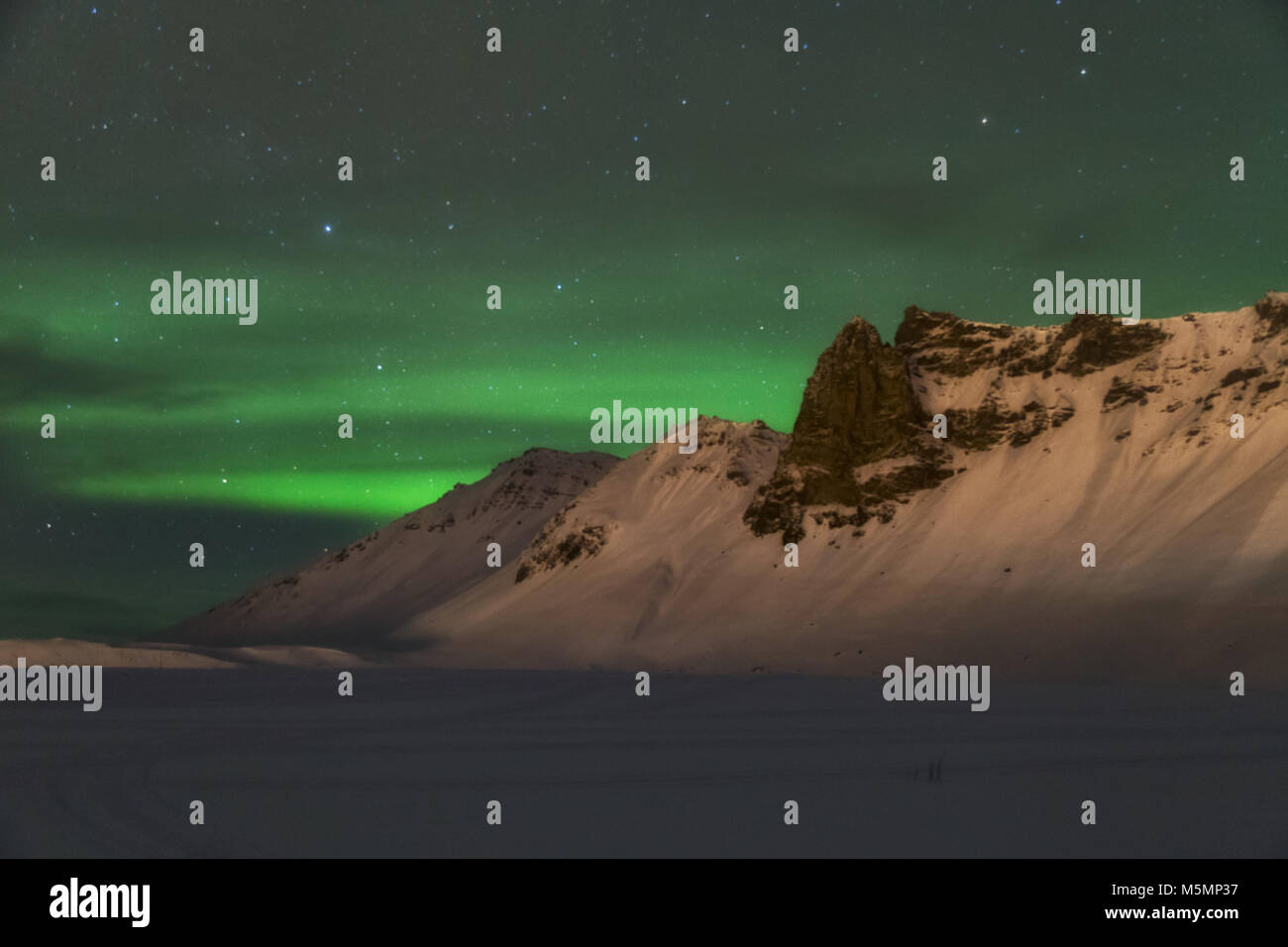 Aurora borealis over the mountains is Iceland - Stock Image