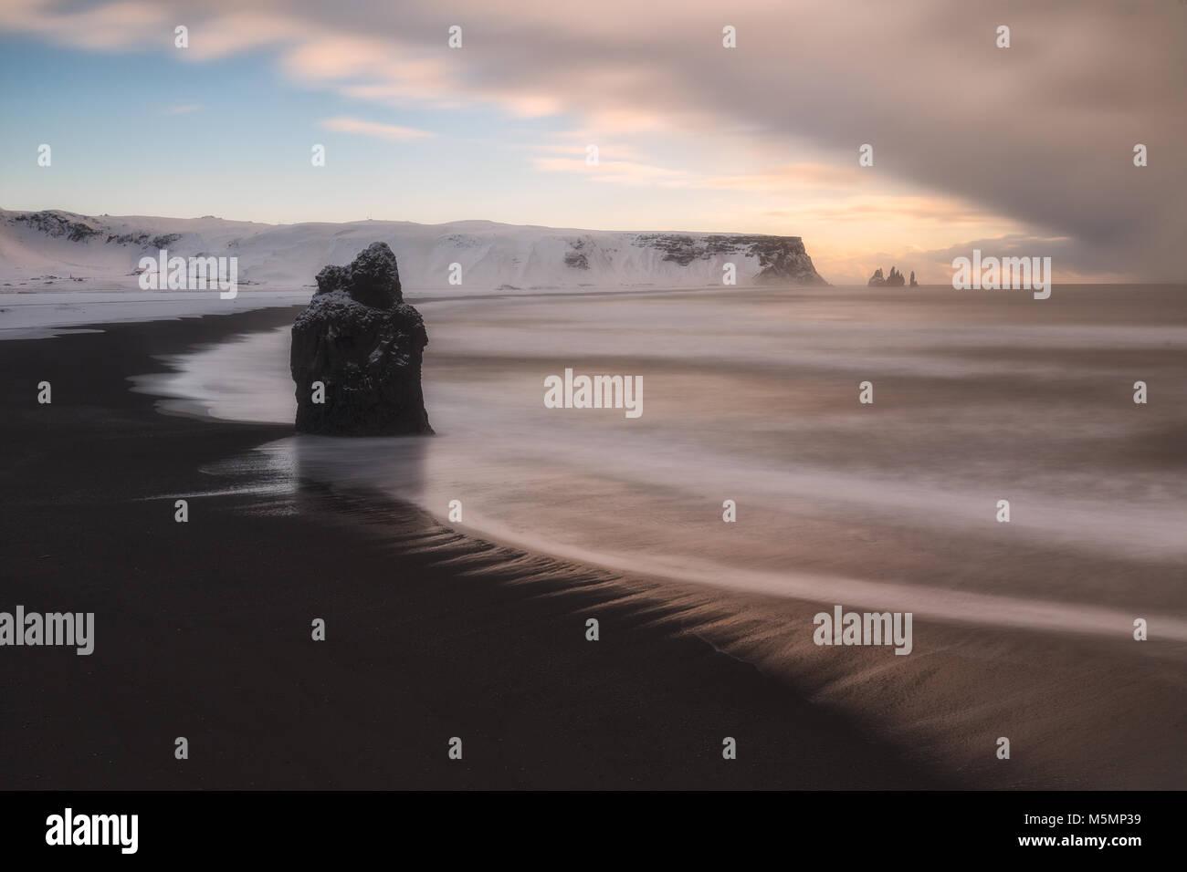 Reynisfjara snowed beach in winter, in Iceland - Stock Image