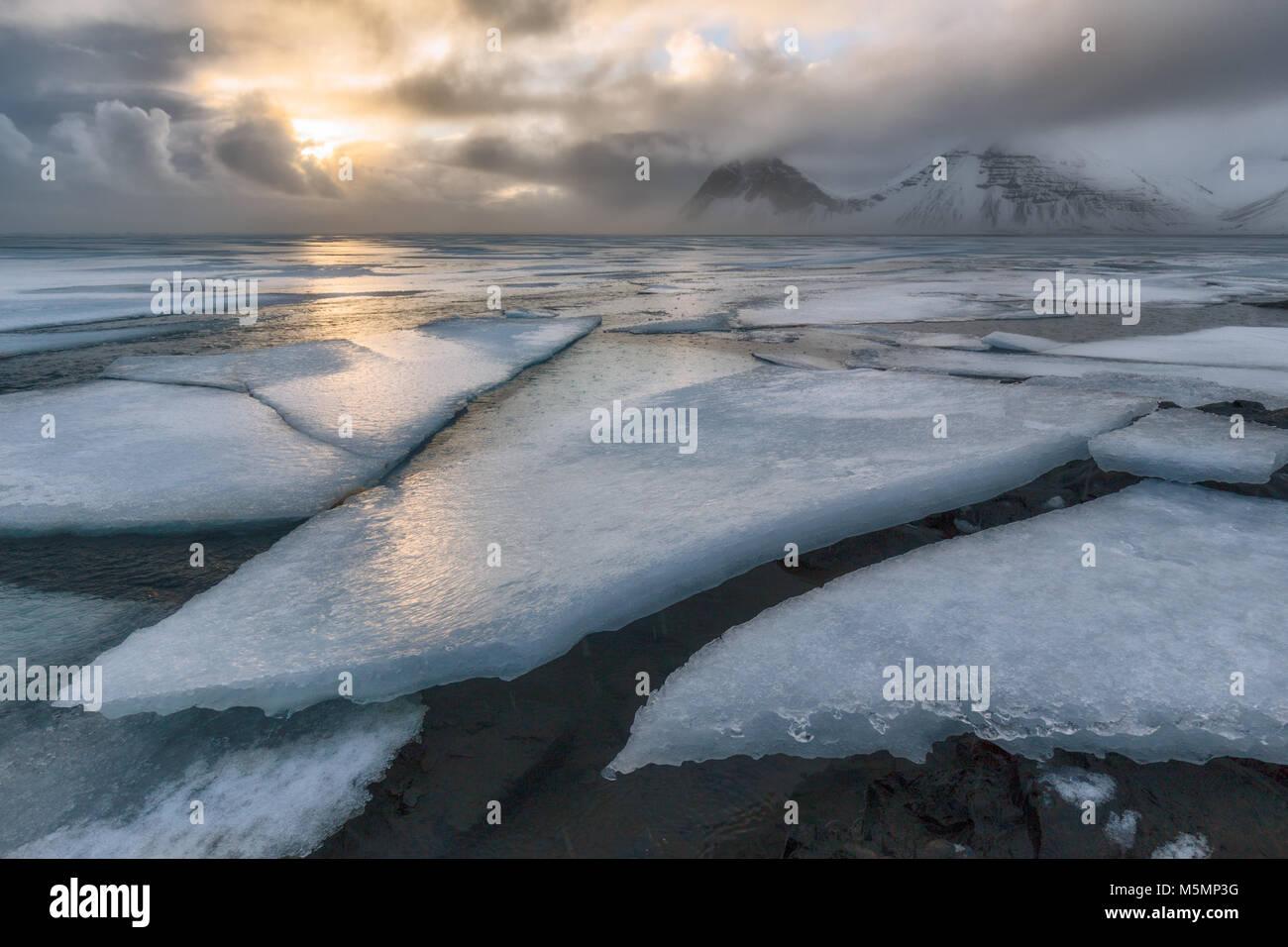 Frozen sea at Vestrahorn in Iceland - Stock Image