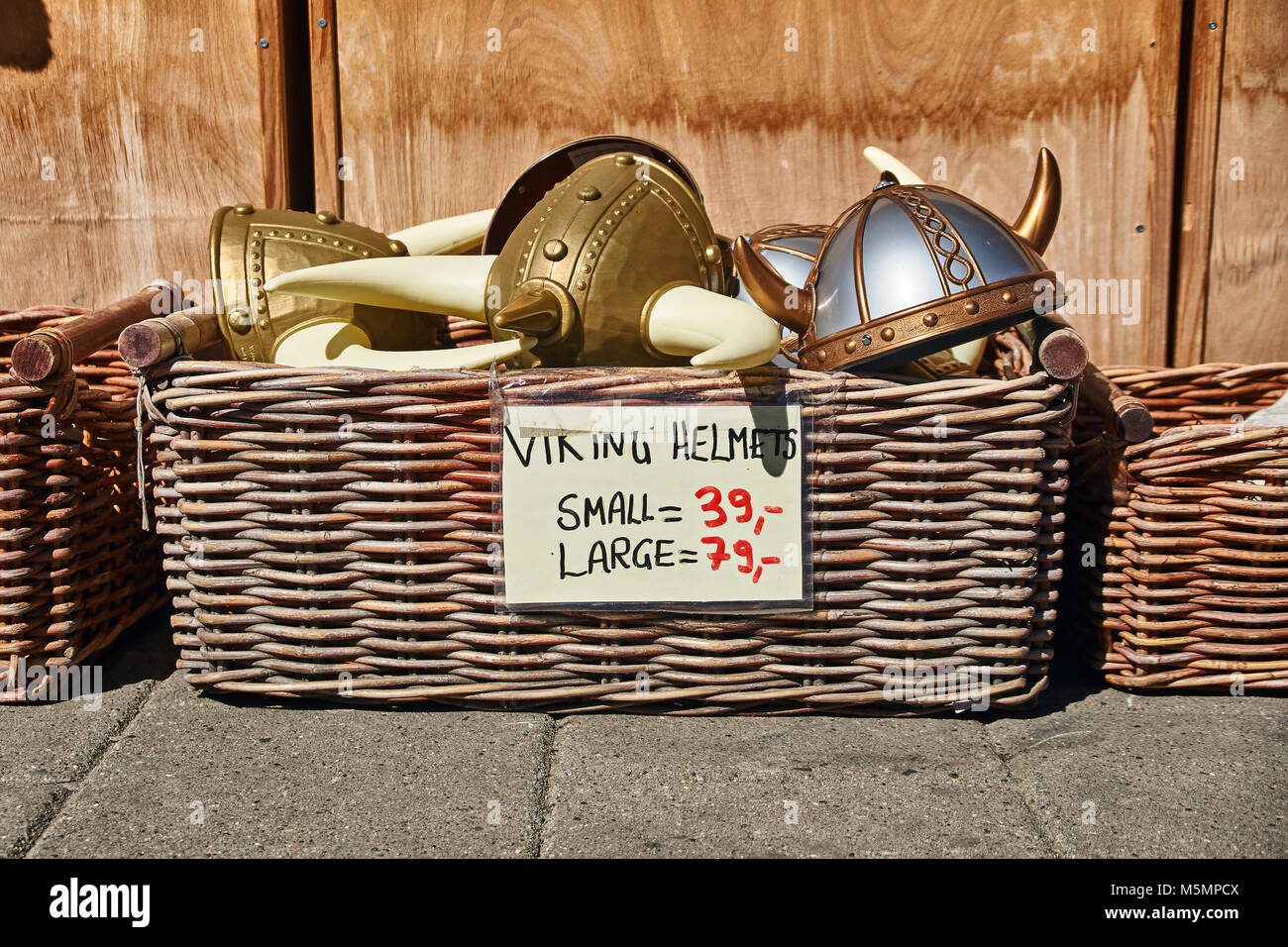 Oslo, Norway: May 1 2017 - Toy horned helmets in traditional Norwegian style in wicker basket are sold on the street Stock Photo