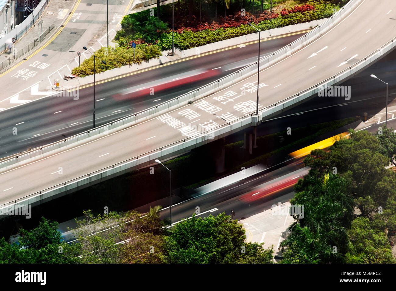 A bird eye view of an elevated highway and cars in motion in the city of Hong Kong, China - Stock Image