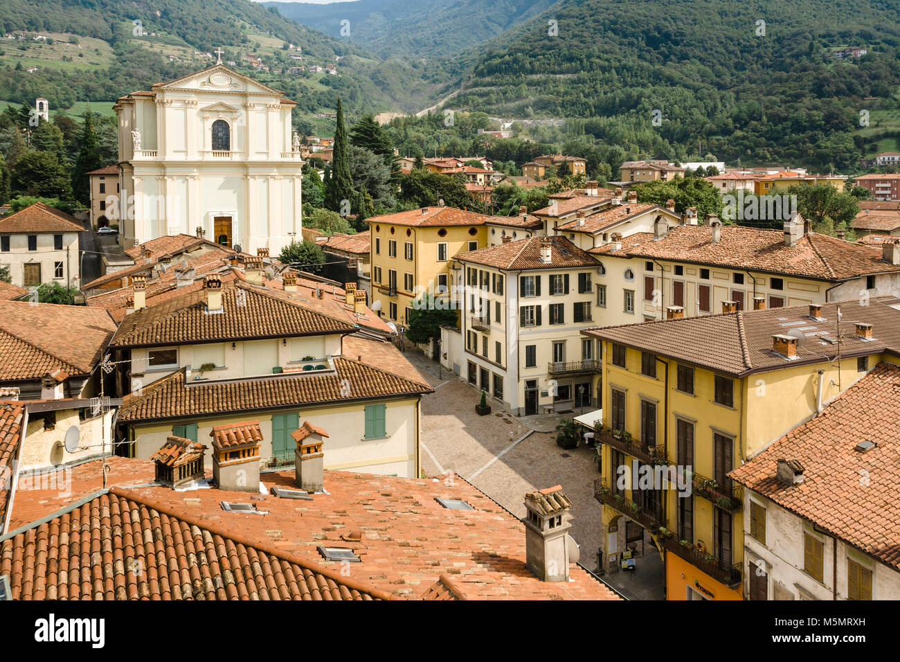 View over rooftops of Pisogne, a small town on the shore of Lake Iseo in the Brescia region of Northern Italy. - Stock Image