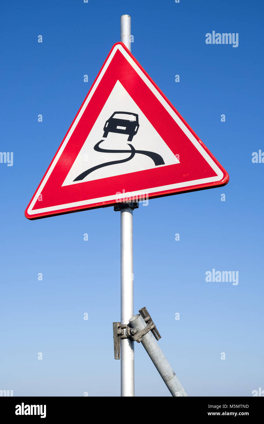 Dutch road sign: slippery road - Stock Image