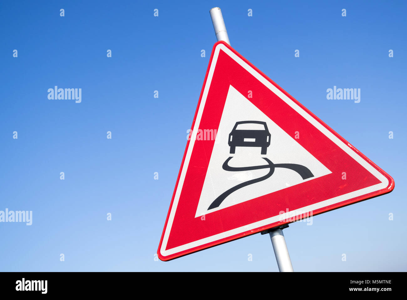 Dutch road sign: slippery road Stock Photo