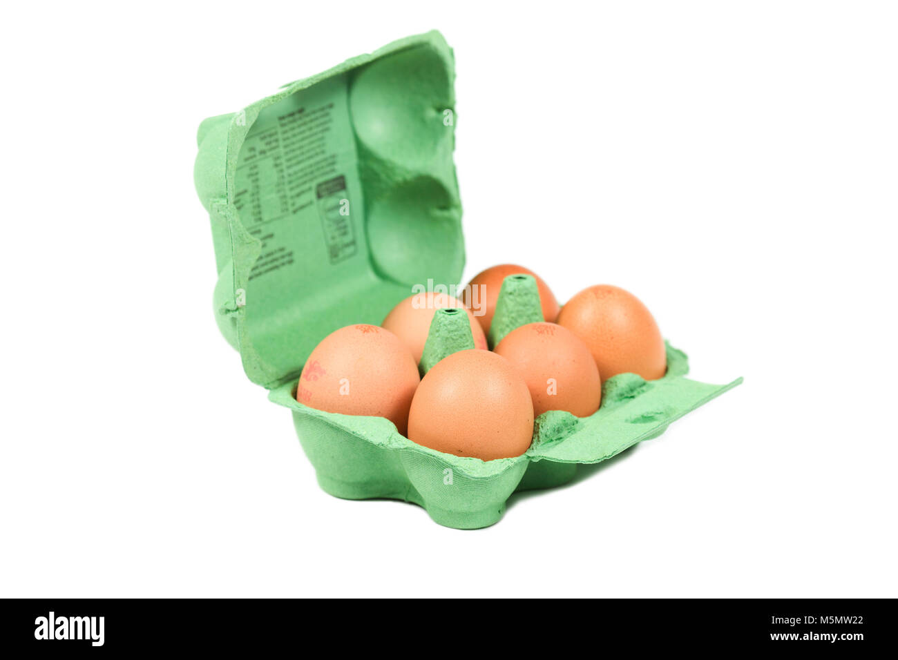 A dozen large eggs in green egg box insulted white background - Stock Image