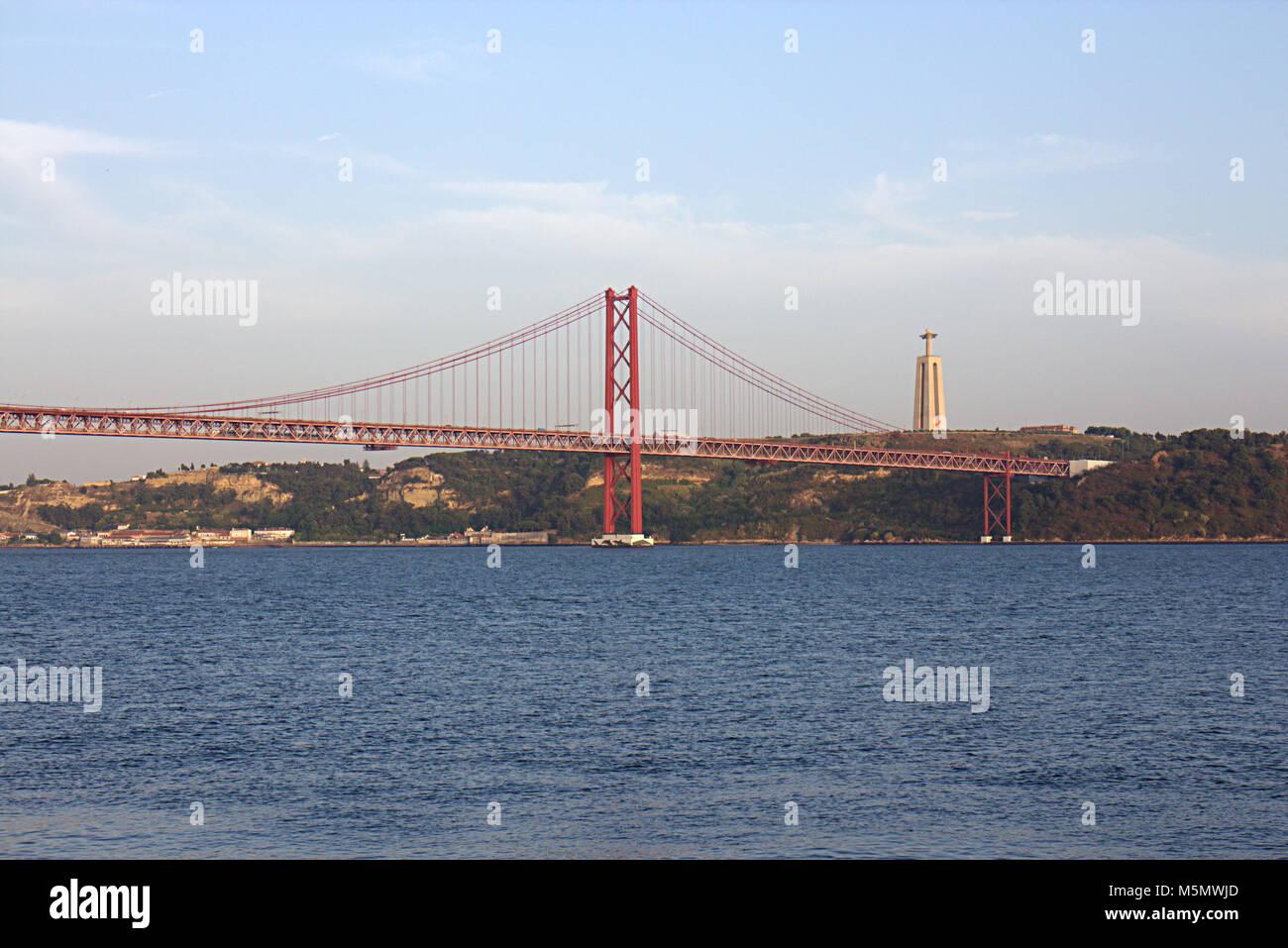 The 25 de Abril Bridge of Lisbon, Almada, over Tejo river, Lisbon portugal Stock Photo