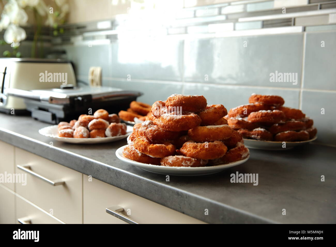 A homemade donut, despite the non-ideal shape, is a taste superior to any other donut purchased in a store or in - Stock Image