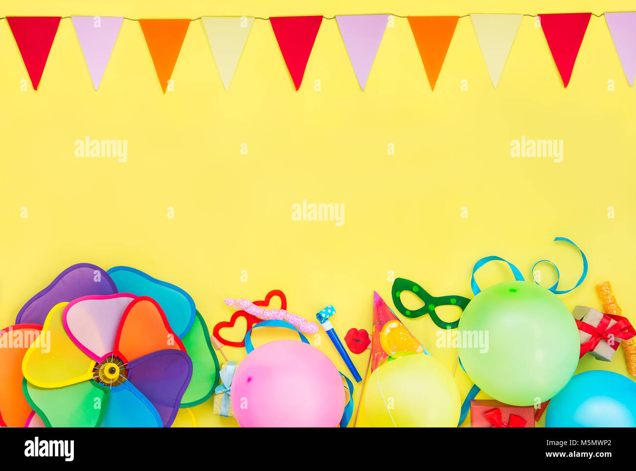 ... Background With Party Tools And Decoration   Baloons, Funny Carnival  Masks, Festive Tinsel And Garland With Flags. Happy Birthday Frame. Design  Concept.