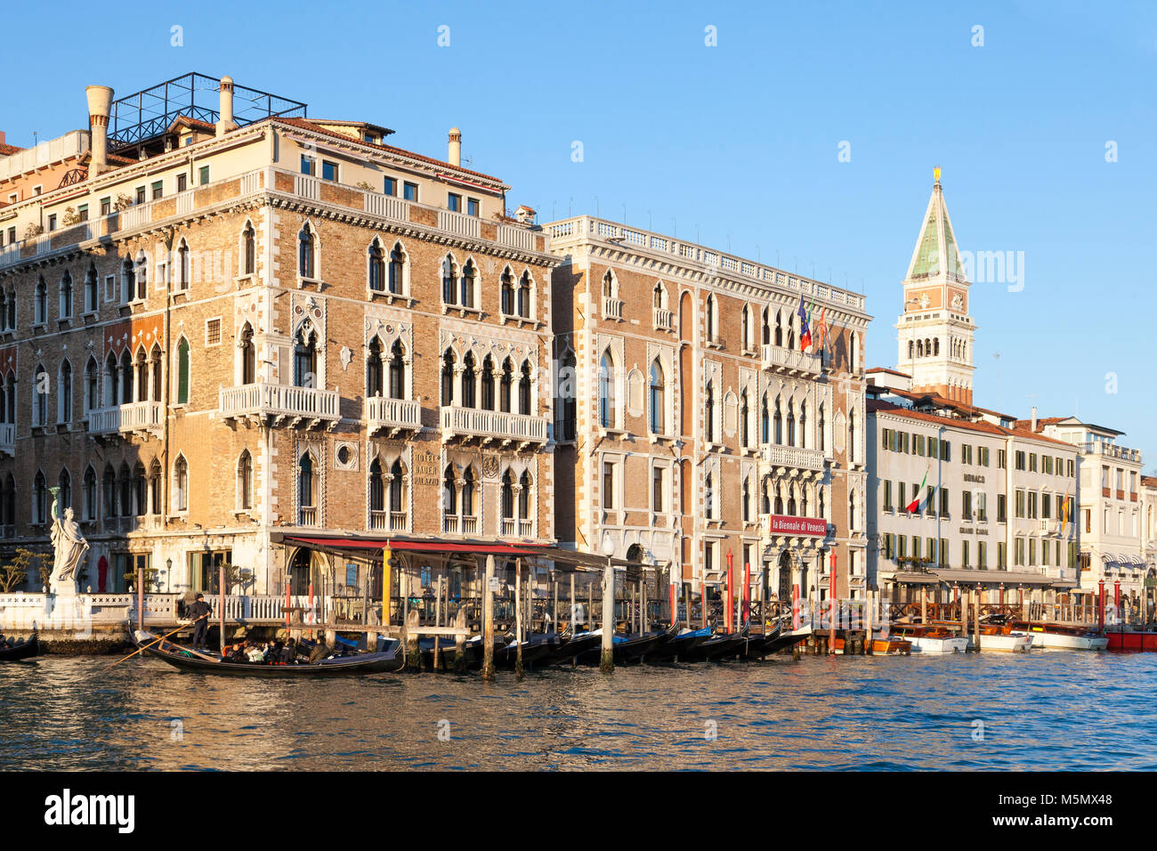 Sunset on the Grand Canal, Hotel Bauer Palazzo, and La Biannale di Venezia, San Marco, Veneto, Venice, Italy with - Stock Image