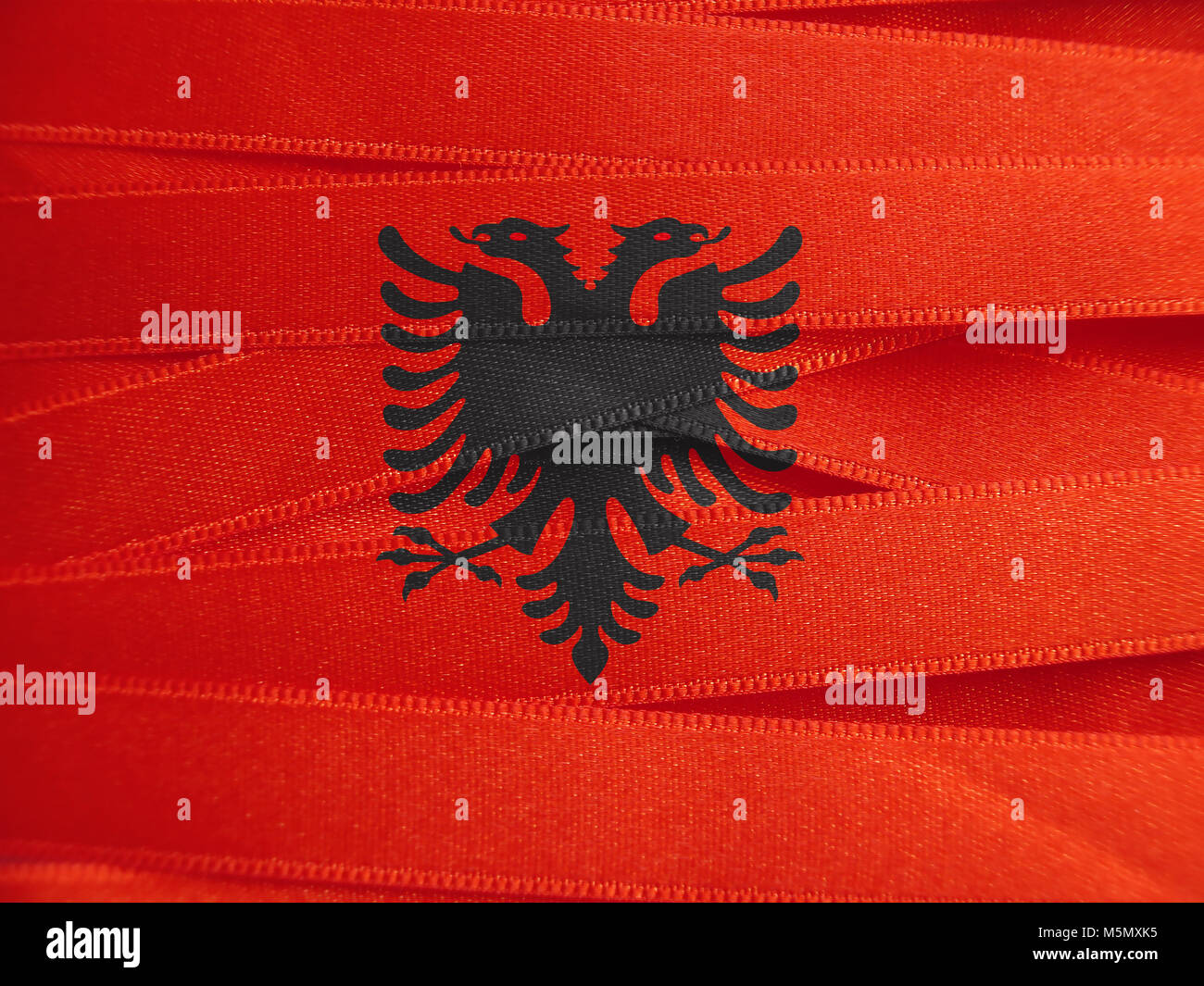 Albania flag or Albanian banner made with ribbons - Stock Image