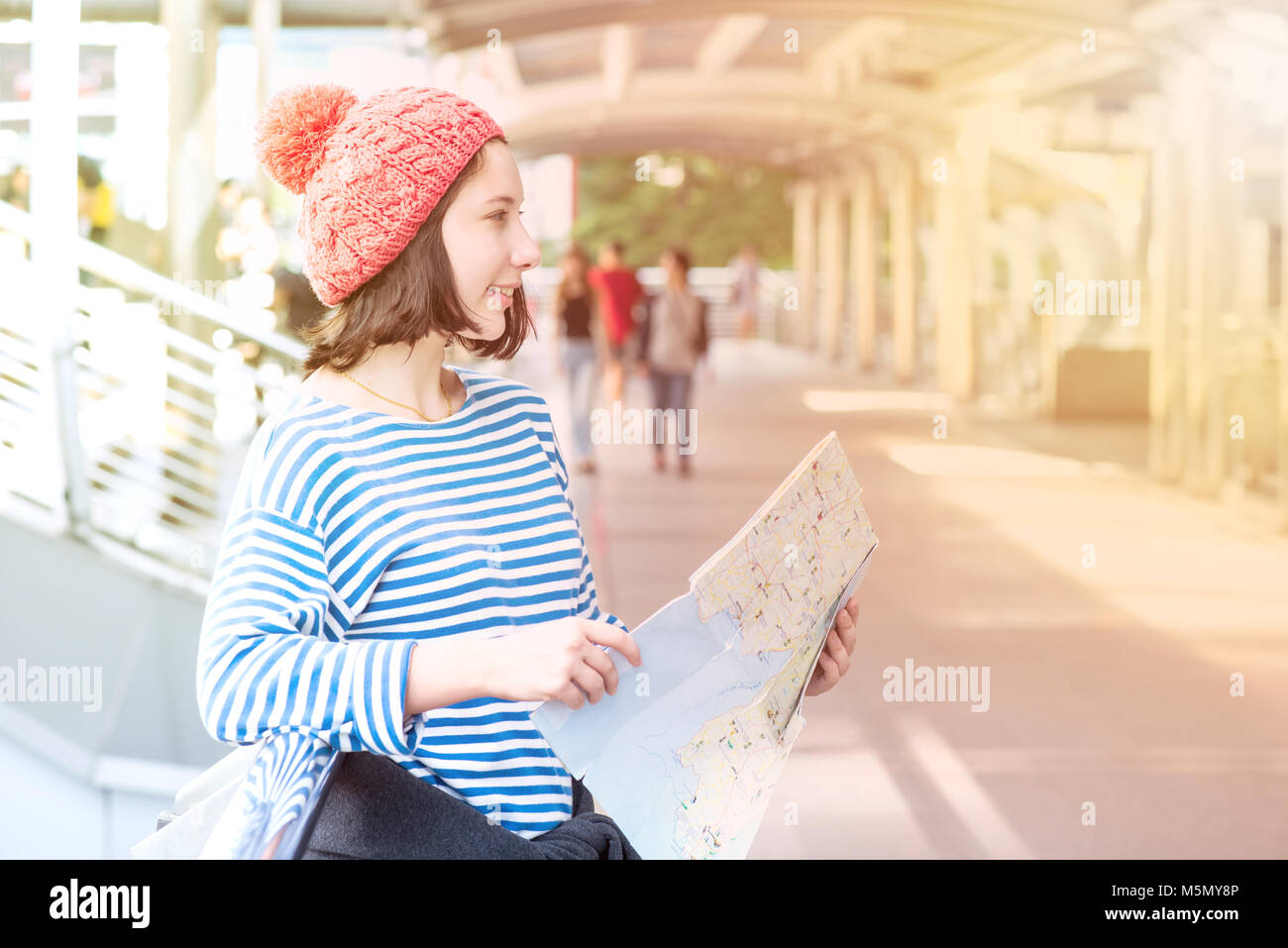 Teenager travel in the city, young tourist girl in Thailand - Stock Image