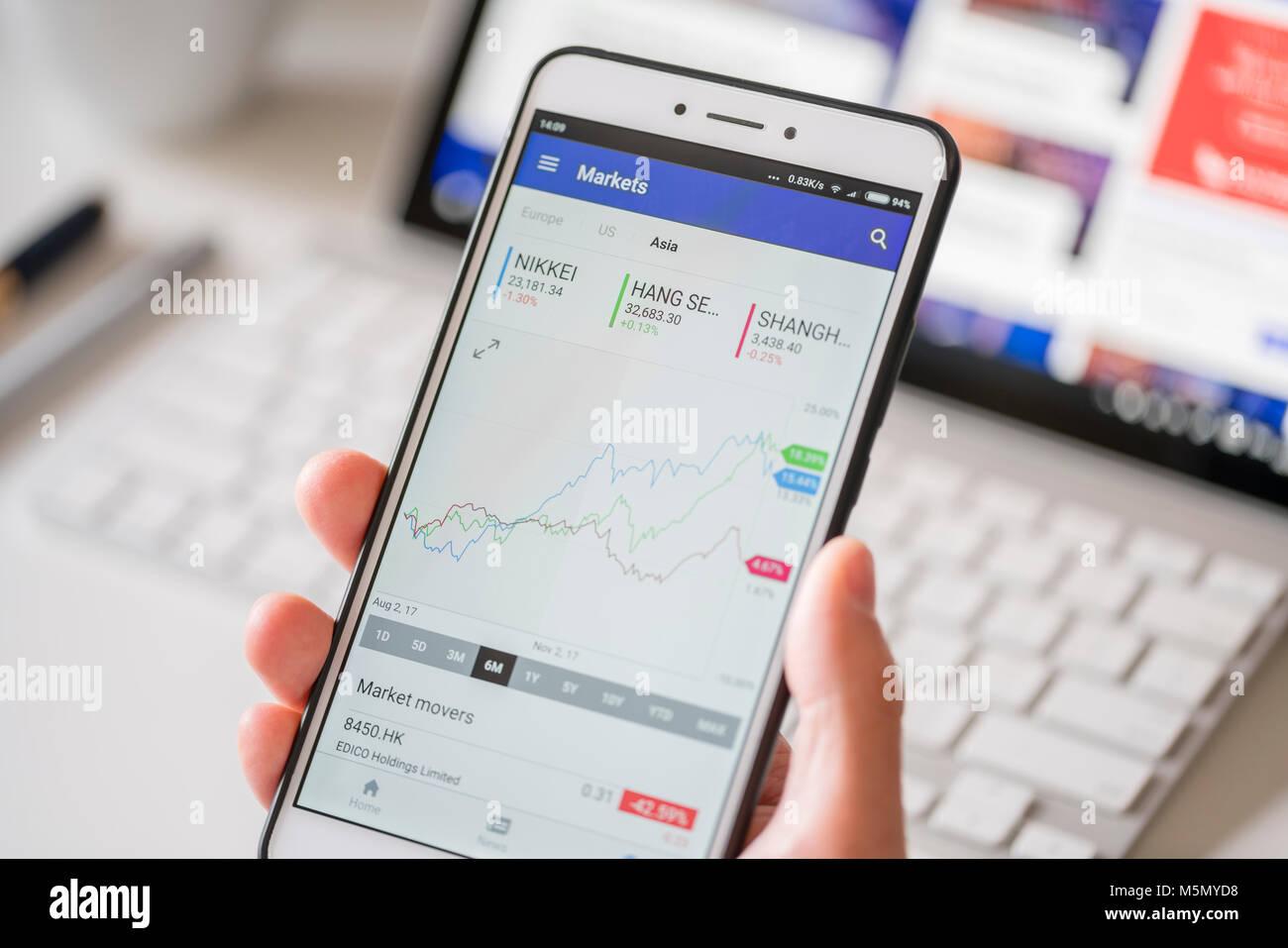 Melbourne, Australia - Feb 2, 2018: Checking data of the Asia stock market on a smartphone - Stock Image
