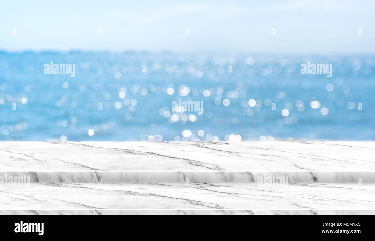 white marble table top. Empty White Marble Table Top With Blur Blue Sky And Sea Boekh Background In Sunny Day,Mock Up Template For Display Or Montage Of Product Content Us